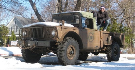 Jeremy atop his refurbished 1967 Jeep Kaiser M-715 military troop carrier. Thing is MASSIVE.