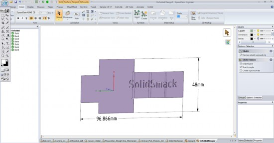 Text and features can be cut into the sheet metal, across the bends in the Flattened state, then.... (Click to Enlarge)