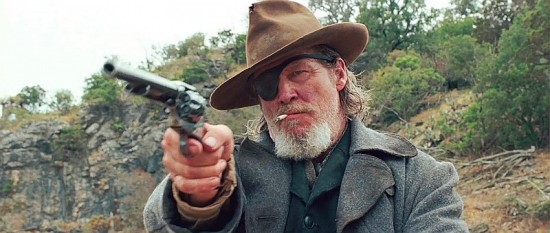 Rooster Cogburn points his SAA. True Grit (2010) © 2010 - Paramount Pictures