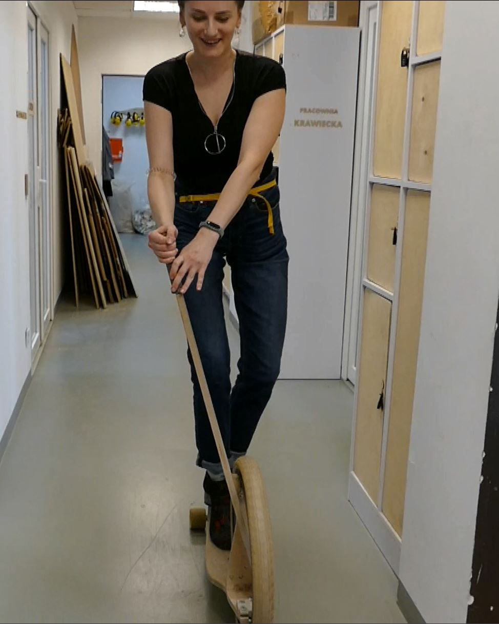 Zaras being a good sport and risking her life to demo this wild-looking wooden scooter thingamabob.